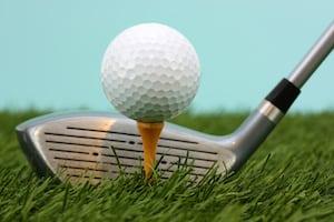 Golf Ball Sitting On A Yellow Tee