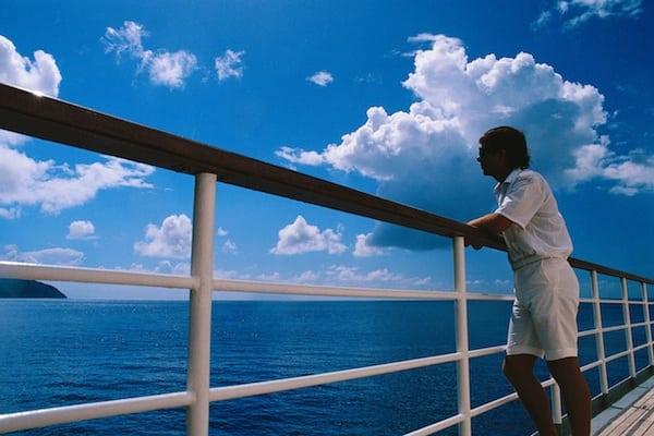 Man Leaning on Cruise Ship Railing